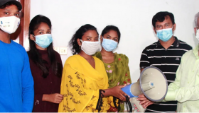 Savitri one of the BEI partners in Rajshahi Savitri got a hand mic to promote corona awareness, The Samakal, 29 July 2021